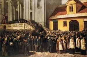 Trumny znoszone są ze stopni kościoła Świętego Krzyża.